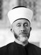 Haj Mohammed Effendi Amin el-Husseini (Arabic: محمد أمين الحسيني‎, Muhammad Amin al-Husayni; born between 1895 and 1897; died July 4, 1974) was a Palestinian Arab nationalist and Muslim leader in the Mandatory Palestine.<br/><br/>  Al-Husseini was an Arab nationalist and following the end of the First World War positioned himself in Damascus, as a supporter of the Arab Kingdom of Syria. However, following the fiasco of the Franco-Syrian War, his positions on pan-Arabism shifted to a form of local nationalism for the Arabs of Palestine and he moved back to Jerusalem. From 1921 to 1937 al-Husseini was the Grand Mufti of Jerusalem, using the position to promote Islam and rally Arab nationalism against Zionism.<br/><br/>  During the 1948 Palestine War, Husseini represented the Arab Higher Committee and opposed both the 1947 UN Partition Plan and King Abdullah's entente with Zionists to annex the Arab part of British Mandatory Palestine to Jordan. In September 1948, he participated in the establishment of an All-Palestine Government. Seated in Egyptian ruled Gaza, this government won a limited recognition of Arab states, but was eventually dissolved by Gamal Nasser in 1959.
